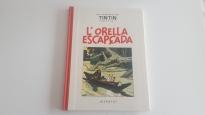 Libro blanco y negro L'orella escapçada (catalán)